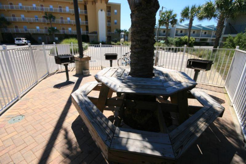 Picnic table near pool with grills
